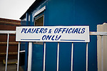 "A sign saying ""players and officials only"" at the Harry Williams Riverside Stadium, home to Ramsbottom United before they played Barwell in a Northern Premier League premier division match. This was the club's 13th league game of the season and they were still to record their first victory following a 3-1 defeat, watched by a crowd of 176. Rams bottom United were formed by Harry Williams, the current chairman, in 1966 and progressed from local amateur football  in Bury to the semi-professional leagues."