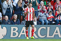 Dusan Tadic celebrates scoring a goal after making it 2-0 during the Barclays Premier League match between Southampton v Swansea City played at St Mary's Stadium, Southampton