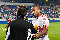 Thierry Henry (14) of the New York Red Bulls talks with Toronto FC head coach Paul Mariner. The New York Red Bulls defeated Toronto FC 4-1 during a Major League Soccer (MLS) match at Red Bull Arena in Harrison, NJ, on September 29, 2012.