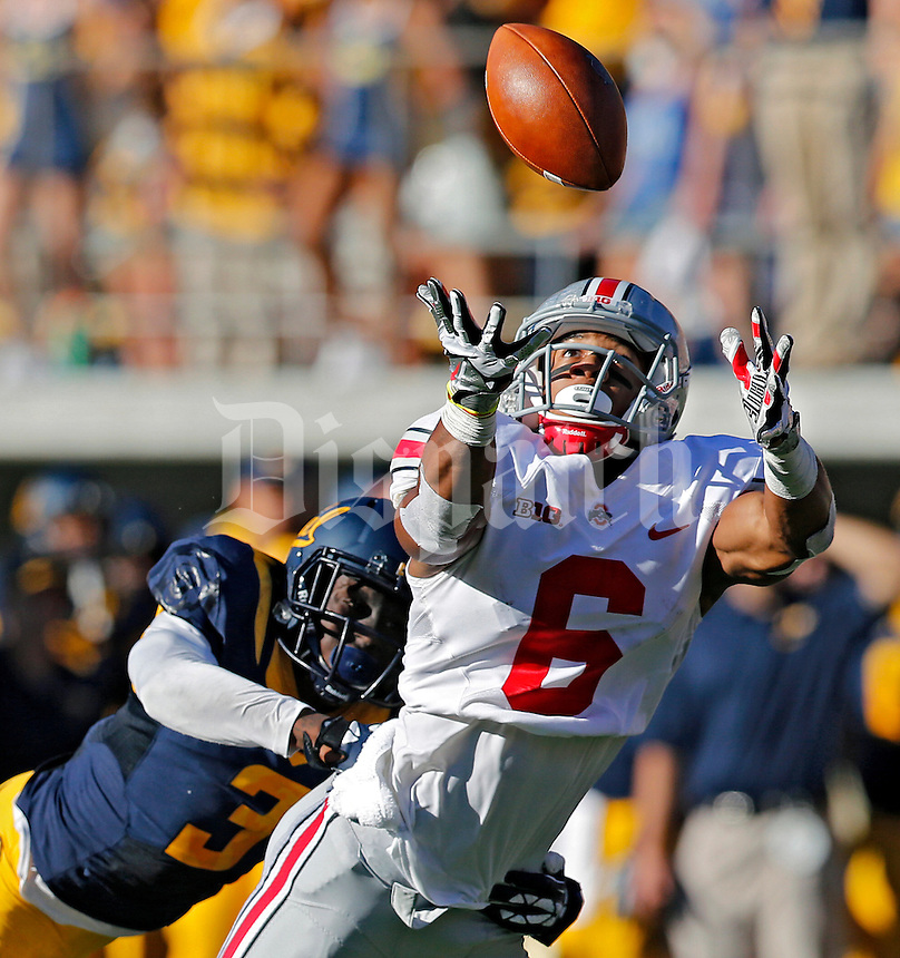 Ohio State Buckeyes wide receiver Evan Spencer (6) can't come up with the catch against California Golden Bears defensive back Kameron Jackson (3) in the 2nd quarter at Memorial Stadium in Berkeley, California on September 14, 2013.  (Dispatch photo by Kyle Robertson)