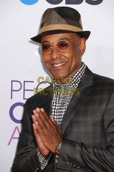 Giancarlo Esposito.People's Choice Awards 2013 - Arrivals held at Nokia Theatre L.A. Live, Los Angeles, California, USA..January 9th, 2013.half length grey gray hat tinted glasses houndstooth dogtooth print shirt suit hands arms together praying headshot portrait .CAP/ADM/BP.©Byron Purvis/AdMedia/Capital Pictures.