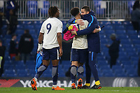 Keanan Bennetts celebrates at the final whistle with a member of the Tottenham staff after scoring both goals in a vital 2-1 victory during Chelsea Under-23 vs Tottenham Hotspur Under-23, Premier League 2 Football at Stamford Bridge on 13th April 2018