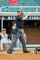 Home plate umpire Brandon Sheeler makes a strike call during the Coastal Plain League game between the Wilson Tobs and the High Point-Thomasville HiToms at Finch Field on June 17, 2013 in Thomasville, North Carolina.  The Tobs defeated the HiToms 3-2 in 11 innings.  Brian Westerholt/Four Seam Images
