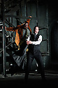 """English Touring Opera presents """"Don Giovanni"""", by Wolfgang Amadeus Mozart, at the Hackney Empire.  Directed by Lloyd Wood, with set & costume design by Anna Fleischle and lighting design by Guy Hoare. Picture shows:  Matthew Stiff (Leporello), George von Bergen (Don Giovanni)."""