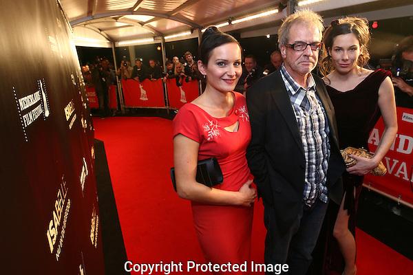 20110922 - Utrecht - Foto: Ramon Mangold - NFF 2011 - Nederlands Filmfestival - .Regisseur Ben Sombogaart (M) geflankeerd door hoofdrolspeelsers Tineke Caels (L) en Halina Reijn (R) op de rode loper bij de premiere van Isabelle.