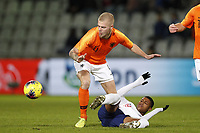 19th November 2019, Stadion De Vijverberg, Doetinchem, Netherlands; U-21 International football freindly, Netherlands versus England; Rick van Dongelen of the Netherlands tackled by Rhian Brewster of England U21