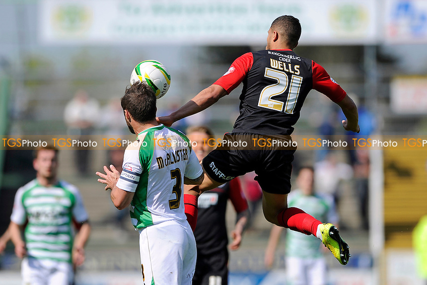 Nahki Wells of Huddersfield Town jumps over Jamie McAllister of Yeovil Town - Yeovil Town vs Huddersfield Town - Sky Bet Championship Football at Huish Park, Yeovil, Somerset - 21/04/14 - MANDATORY CREDIT: Denis Murphy/TGSPHOTO - Self billing applies where appropriate - 0845 094 6026 - contact@tgsphoto.co.uk - NO UNPAID USE