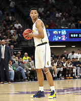 SACRAMENTO, CA - November 21, 2016: Cal Bears Men's Basketball team vs. the San Diego State University Aztecs at Golden 1 Center. Final score, Cal Bears 65, San Diego State University Aztecs 77.