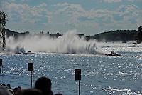 "Final heat: Brandon Kennedy, GP-25 ""Miss KOMA Unwind"" pushes leader Ghislain Marcoux, GP-101 ""Groupe ABS"" (Grand Prix Hydroplane(s)"