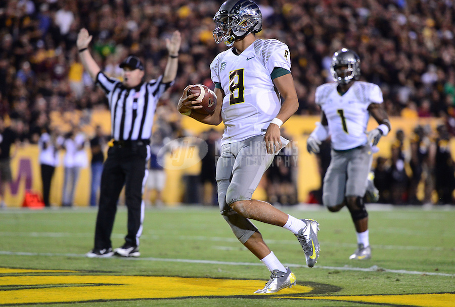 Oct. 18, 2012; Tempe, AZ, USA; Oregon Ducks quarterback (8) Marcus Mariota runs for a first half touchdown against the Arizona State Sun Devils at Sun Devil Stadium. Oregon defeated Arizona State 43-21. Mandatory Credit: Mark J. Rebilas-