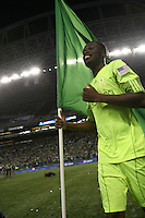 Steve Zakuani (11)of the Seattle Sounders FC runs with a flag. The Seattle Sounders FC defeated the Columbus Crew 2-1 during the US Open Cup Final at Qwest Field in Seattle,WA, on October 5, 2010.