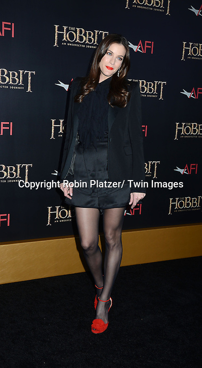 "Liv Tyler in black shorts and red shoes attends the US Premiere of ""The Hobbit"" on December 6, 2012 at the Ziegfeld Theatre in New York City."