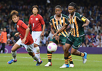 July 31, 2012..Japan's Asuna Tanaka (14) and South Africa's Amanda Dlamini (9) in action during Football match between JPN and RSA at the Millennium Stadium on day four of 2012 Olympic Games  in Cardiff, United Kingdom...