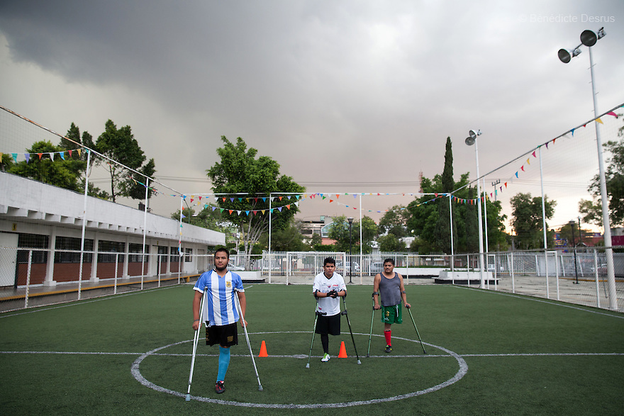"""Players from Guerreros Aztecas train at a football ground in Mexico City, Mexico on June 11, 2014. Guerreros Aztecas (""""Aztec Warriors"""") is Mexico City's first amputee football team. Founded in July 2013 by five volunteers, they now have 23 players, seven of them have made the national team's shortlist to represent Mexico at this year's Amputee Soccer World Cup in Sinaloathis December.The team trains twice a week for weekend games with other teams. No prostheses are used, so field players missing a lower extremity can only play using crutches. Those missing an upper extremity play as goalkeepers. The teams play six per side with unlimited substitutions. Each half lasts 25 minutes. The causes of the amputations range from accidents to medical interventions – none of which have stopped the Guerreros Aztecas from continuing to play. The players' age, backgrounds and professions cover the full sweep of Mexican society, and they are united by the will to keep their heads held high in a country where discrimination against the disabled remains widespread.(Photo byBénédicte Desrus)"""