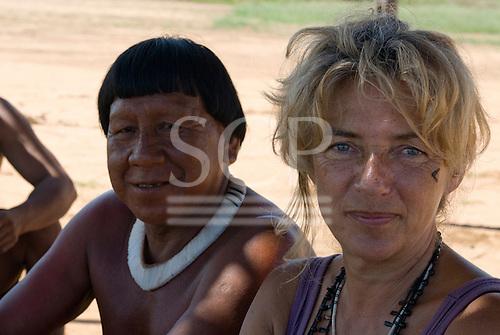 Xingu Indigenous Park, Mato Grosso State, Brazil. Aldeia Aweti. Cacique Kalucuma and Sue Cunningham.
