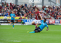 Devante Cole of Fleetwood Town gets past Ash Taylor of Northampton Town to score the opening goal during the Sky Bet League 1 match between Northampton Town and Fleetwood Town at Sixfields Stadium, Northampton, England on 12 August 2017. Photo by Alan  Stanford / PRiME Media Images.