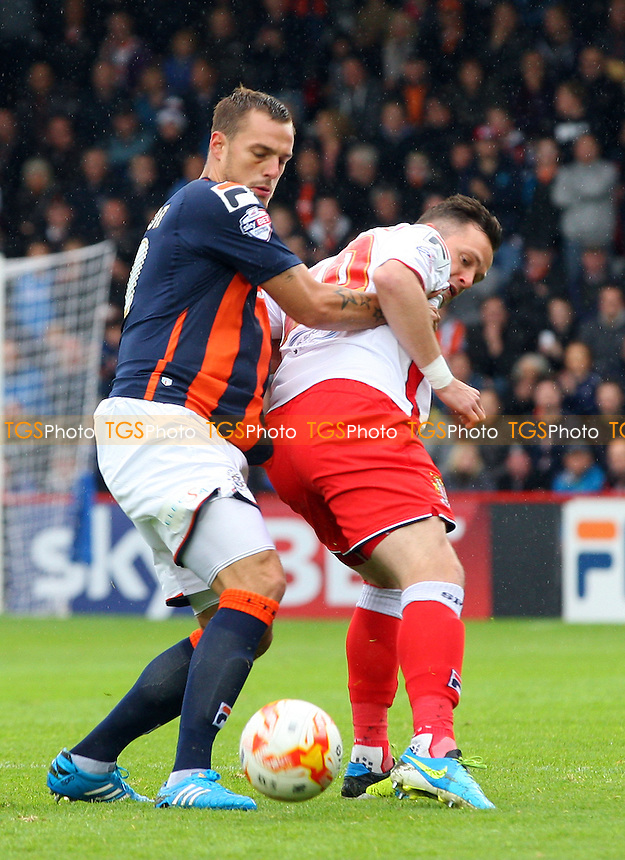 Luke Wilkinson of Luton Town and Chris Beardsley of Stevenage - Stevenage vs Luton Town - Sky Bet League Two action at the Lamex Stadium on 04/10/2014 - MANDATORY CREDIT: Dave Simpson/TGSPHOTO - Self billing applies where appropriate - 0845 094 6026 - contact@tgsphoto.co.uk - NO UNPAID USE