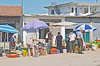 Street scene with food market stalls selling fruits and vegetables, big water melons Shkodra. Albania, Balkan, Europe.