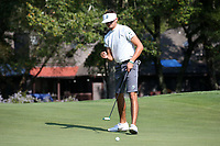 SAPPHIRE, NC - OCTOBER 01: Christopher Williard of Stetson University sinks a putt at The Country Club of Sapphire Valley on October 01, 2019 in Sapphire, North Carolina.