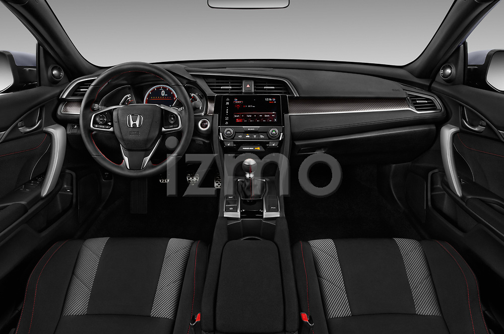 Stock photo of straight dashboard view of a 2017 Honda Civic Si 2 Door Coupe