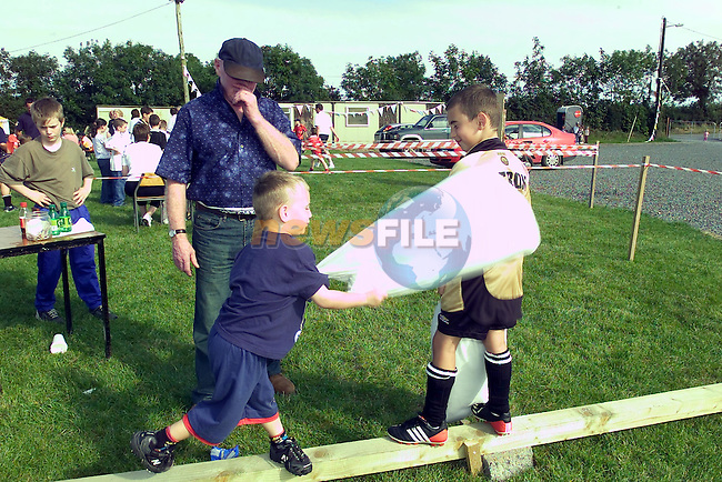Conor and Shane carolan having a bit of Fun at the Walshestown FC Sports Day..Picture Fran Caffrey Newsfile...This Picture is sent to you by:..Newsfile Ltd.The View, Millmount Abbey, Drogheda, Co Louth, Ireland..Tel: +353419871240.Fax: +353419871260.GSM: +353862500958.ISDN: +353419871010.email: pictures@newsfile.ie.www.newsfile.ie
