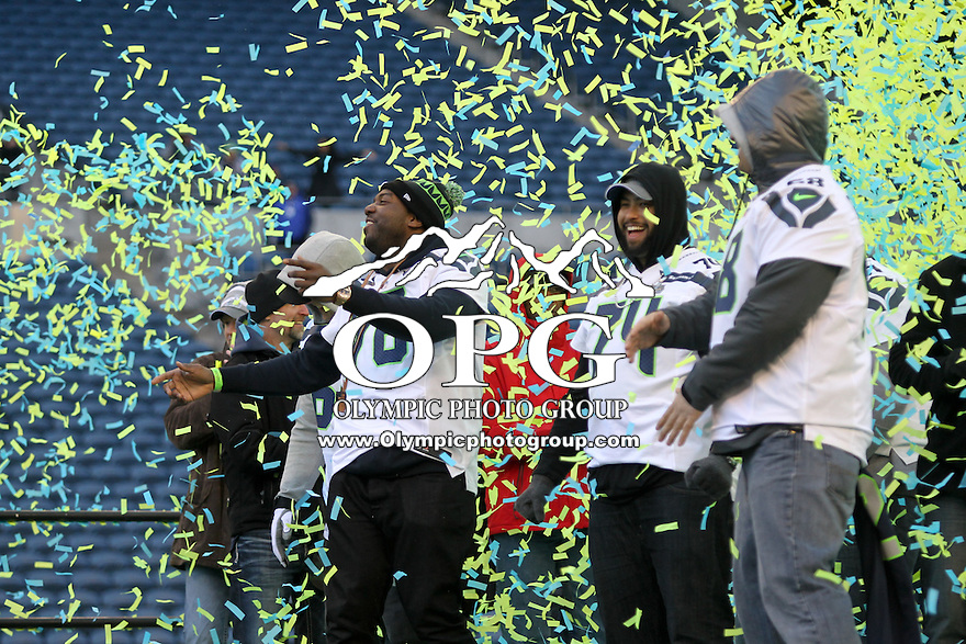 2014-02-05:  Seattle Seahawks lineman Russell Okung celebrated wit hteammates on stage.  Seattle Seahawks players and 12th man fans celebrated bringing the Lombardi trophy home to Seattle during the Super Bowl Parade at Century Link Field in Seattle, WA.
