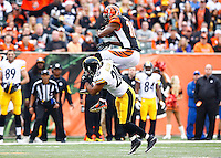 A.J. Green #18 of the Cincinnati Bengals catches a pass over top of Will Allen #20 of the Pittsburgh Steelers in the second half during the game at Paul Brown Stadium on December 12, 2015 in Cincinnati, Ohio. (Photo by Jared Wickerham/DKPittsburghSports)