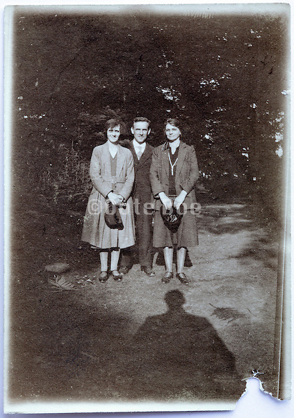 damaged vintage photo of three adult people posing 1920s
