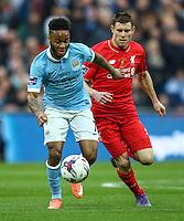 Raheem Sterling of Manchester City and James Milner of Liverpool during the Capital One Cup match between Liverpool and Manchester City at Wembley Stadium, London, England on 28 February 2016. Photo by David Horn / PRiME Media Images.