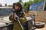 An IDF soldier stands guard following a demonstration by Palestinians in the village of An Nabi Salih near Ramallah on 11/06/2010. The demonstrators had been protesting against the planned demolition of village houses by the Israeli military.