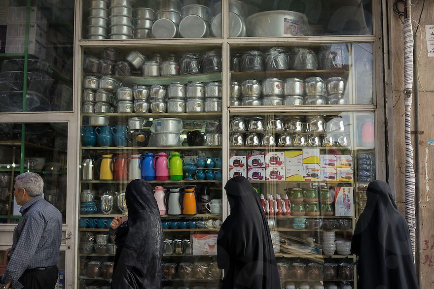 June 07, 2014 - Tabriz, Iran. People pass by a homeware shop in central Tabriz at the entrance of the Grand Baazar, one of the oldest and more important in the country. © Thomas Cristofoletti / Ruom
