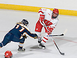 MADISON, WI - SEPTEMBER 29: Jasmine Giles #2 of the Wisconsin Badgers women's hockey team handles the puck against the Quinnipiac Bobcats at the Kohl Center on September 29, 2006 in Madison, Wisconsin. The Badgers beat the Bobcats 3-0. (Photo by David Stluka)