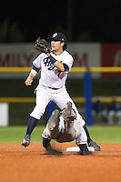 Dansby Swanson (7) of the Hillsboro Hops covers second base during a stolen base attempt in a game against the Tri-City Dust Devils at Ron Tonkin Field in Hillsboro, Oregon on August 24, 2015.  Tri-City defeated Hillsboro 5-1. (Ronnie Allen/Four Seam Images)