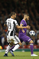 Calcio, Champions League: finale Juventus vs Real Madrid. Cardiff, Millennium Stadium, 3 giugno 2017.<br /> Real Madrid's Karim Benzema (r) in action with Juventus  Leonardo Bonucci (l) during the Champions League final match between Juventus and Real Madrid at Cardiff's Millennium Stadium, Wales, June 3, 2017. Real Madrid won 4-1.<br /> UPDATE IMAGES PRESS/Isabella Bonotto