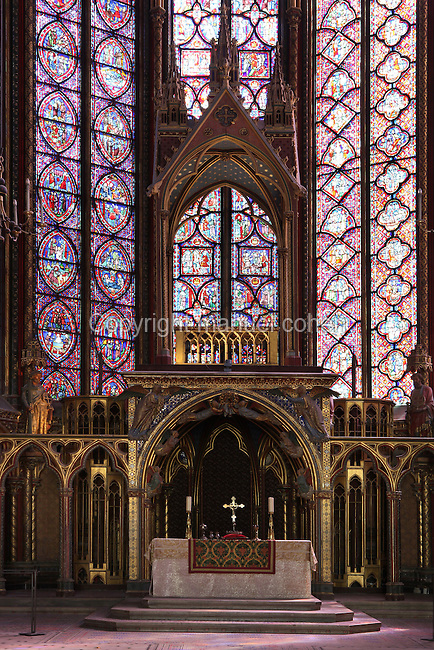 General view of the altar and the reliquary, built on the pattern of the chapel, Upper chapel of La Sainte-Chapelle ( (The Holy Chapel), 1248, Paris, France. La Sainte-Chapelle was commissioned by King Louis IX to house his collection of Passion Relics, including the Crown of Thorns. The central window in the choir is dedicated to the Passion. In the choir, the windows have only two lancets. The most famous features of the chapel are the great stained glass windows. Fifteen huge mid-13th century windows fill the nave and apse. Picture by Manuel Cohen