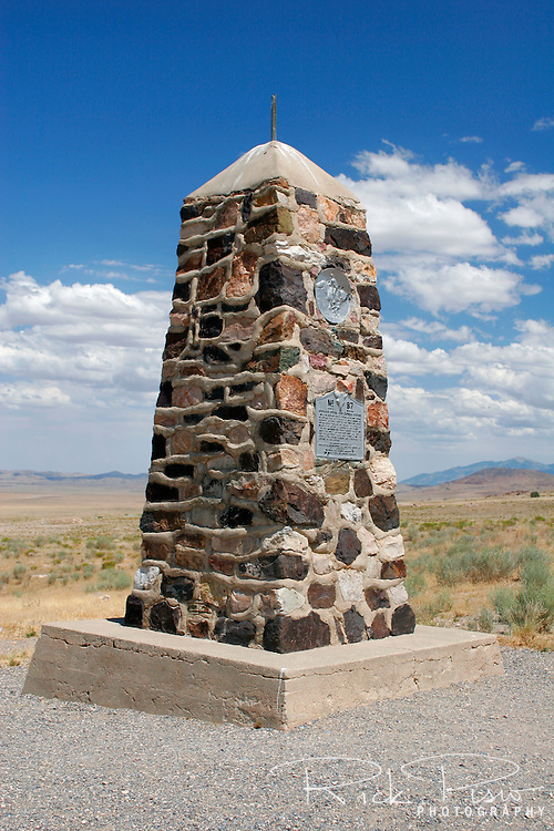 An obelisk marks the location of the Simpson Springs Pony Express Station near Simpson Springs in Utah's Great Salt Lake Desert. The monument was erected by the Civilian Conservation Corps in 1939 or 1940 along with other sites along the Pony Express trail in Utah. The Pony Express operated as a fast mail service from April 1860 to October 1861 between St. Joseph, Missouri, to Sacramento, California. Riders mounted on horseback carried mail across the prairies, plains, deserts, and mountains significantly reducing the time it took for the mail to travel between the Atlantic and Pacific coasts to ten days. Photographed 07/07
