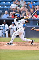 Asheville Tourists catcher Hidekel Gonzalez (15 ) swings at a pitch during a game against the Greensboro Grasshoppers at McCormick Field on May 11, 2018 in Asheville, North Carolina. The Tourists defeated the Grasshoppers 10-5. (Tony Farlow/Four Seam Images)