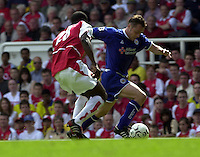 Photo. © Peter Spurrier/Intersport Images.15/05/2004  - 2003/04 Premiership Football - Arsenal v Leicester City:.Paul Dickov tries to get around Kolo Toure.[Credit] Peter Spurrier Intersport Images