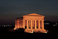 General view of the Temple of Concord, 5th century BC, Agrigento, Sicily, Italy,  pictured on September 11, 2009, floodlit at night. Well preserved owing to its 6th century AD conversion to a church, the Temple of Concord is a typical example of optical correction whose tapering columns create the illusion of a perfectly aligned building. Its frieze consists of alternating triglyphs and metopes, and the pediment is undecorated. The Valley of the Temples is a UNESCO World Heritage Site. Picture by Manuel Cohen.