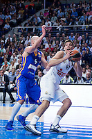 Real Madrid's Willy Hernangómez and Khimki Moscow's James Augustine during Euroleague match at Barclaycard Center in Madrid. April 07, 2016. (ALTERPHOTOS/Borja B.Hojas) /NortePhoto