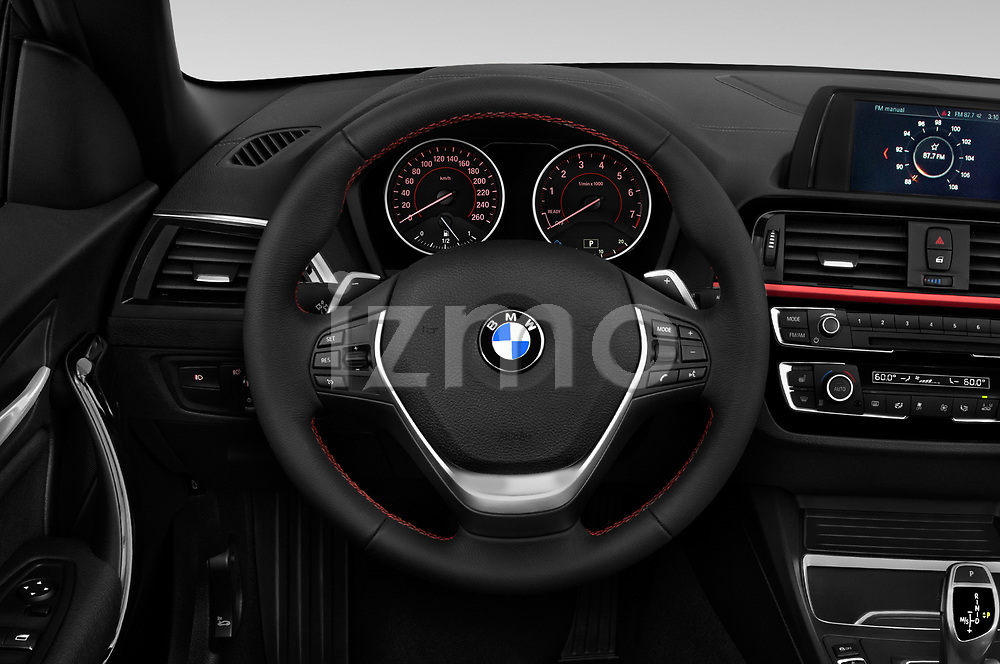 Car pictures of steering wheel view of a 2018 BMW 2 Series Sport 2 Door Convertible