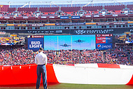 Landover, MD - November 4, 2018: A soldier hold the United States flag as the fly over is visible on the jumbo-tron before game between the Atlanta Falcons and the Washington Redskins at FedEx Field in Landover, MD. (Photo by Phillip Peters/Media Images International)