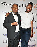 MNEK (Uzoechi &quot;Uzo&quot; Emenike) and his father at the Lux Afrique gala dinner, Claridge's Hotel, Brook Street, London, England, UK, on Sunday 01 October 2017.<br /> CAP/CAN<br /> &copy;CAN/Capital Pictures
