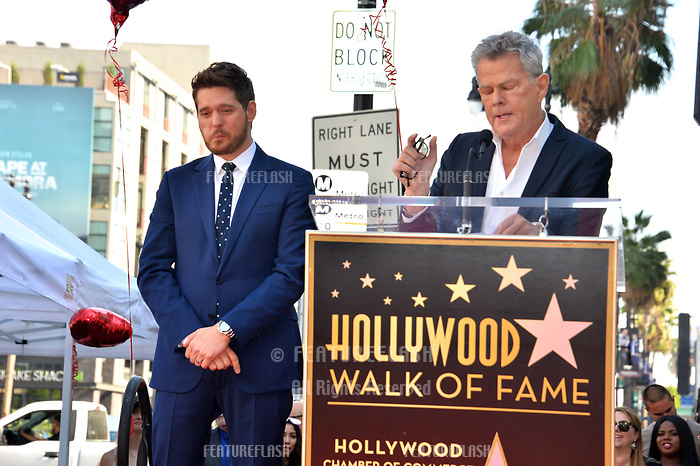 LOS ANGELES, CA. November 16, 2018: Michael Buble & David Foster at the Hollywood Walk of Fame Star Ceremony honoring singer Michael Bublé.<br /> Pictures: Paul Smith/Featureflash