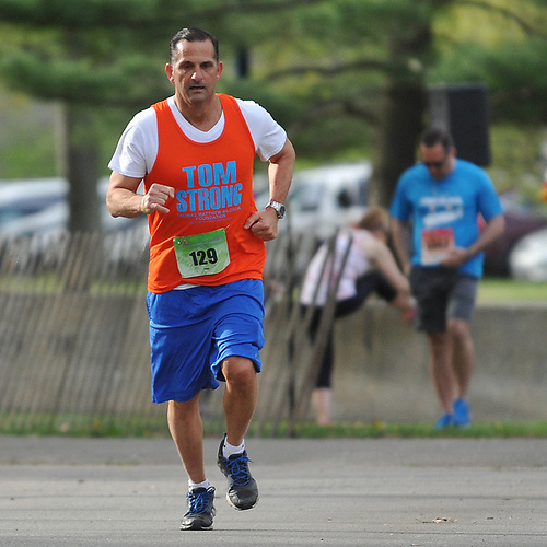 Joe Miloscia participates in the inaugural 1-mile race as part of Long Island Marathon Weekend at Eisenhower Park on Saturday, May 5, 2018. He and family members ran to honor the memory of his son, Thomas Matthew Miloscia, who died of an aggressive form of cancer in October 2015 at the age of 18. The Thomas Matthew Miloscia Foundation has since been founded in order to support families with members battling the illness.