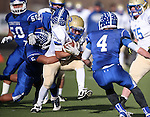 Reed's Jorden Carter runs against Carson defenders Gerardo Lobato and Asa Carter during the NIAA D-1 Northern Regional title game at Bishop Manogue High School in Reno, Nev., on Saturday, Nov. 29, 2014. Reed won 28-25.<br /> Photo by Cathleen Allison