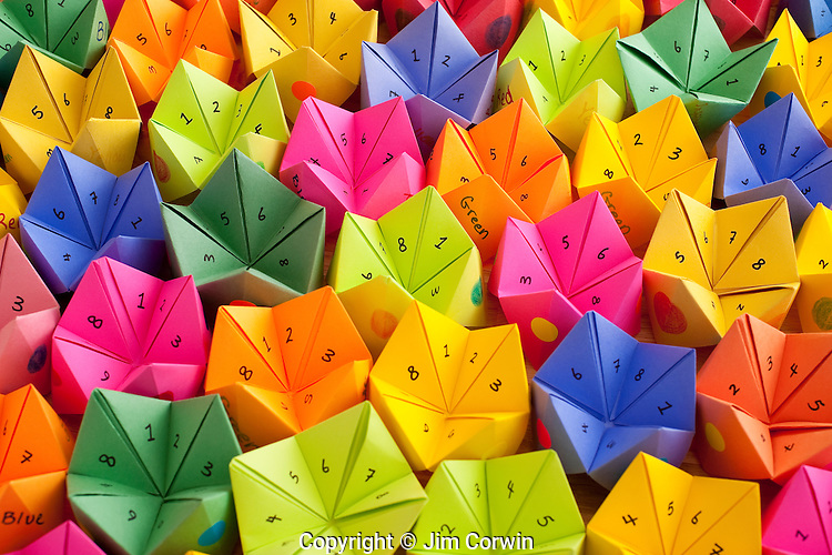 Multicolored cootie catchers with numbers and positive words of encouragement game of chance