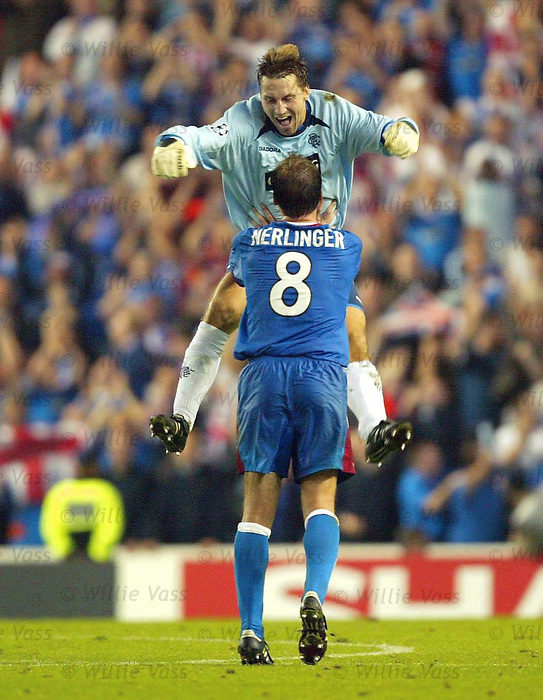 Stefan Klos celebrates with Christian Nerlinger as Rangers defeat Stuttgart in the Champions League at Ibrox sept 2003