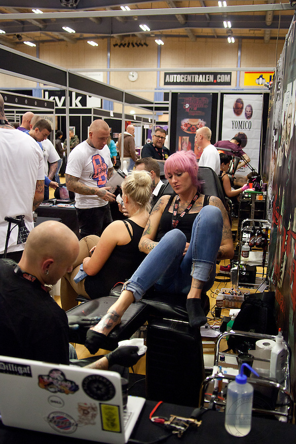 Tattoo Convention in Kolding 2011. Arranged by BodyMod.dk<br /> Young woman getting tattoed at King Pin Tattoo