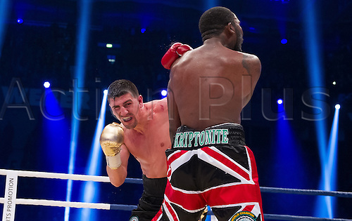 27.02.2016. Halle, Germany.  Marco Huck (L, Germany) and Ola Afolabi (Great Britain) fight during the cruiserweight boxing match at the IBO World Championships in Halle, Germany, 27 February 2016. Marco Huck won in the 10th round.